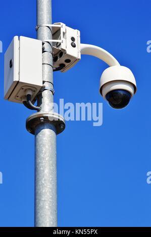 Hi-tech dome type camera over blue sky. - Stock Photo