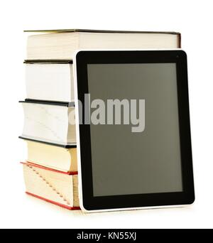 Composition with books and tablet computer isolated on white background. - Stock Photo