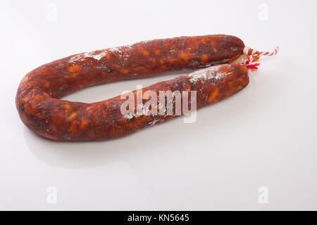 Red spanish chorizo sausage. Isolated over white background. - Stock Photo