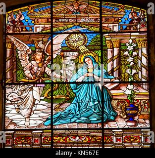 Annuciation Angel Gabriel Tells Mary She Will Give Birth to Jesus Stained Glass Old Basilica Guadalupe Mexico City - Stock Photo