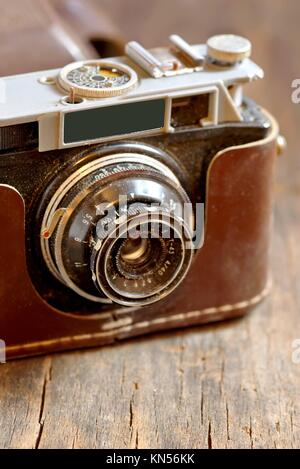 Old film camera on wooden background. - Stock Photo