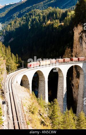 train on Rhaetian Railway, Landwasserviadukt, canton Graubunden, Switzerland. - Stock Photo