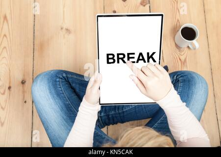 woman pointin on break written on tablet. - Stock Photo