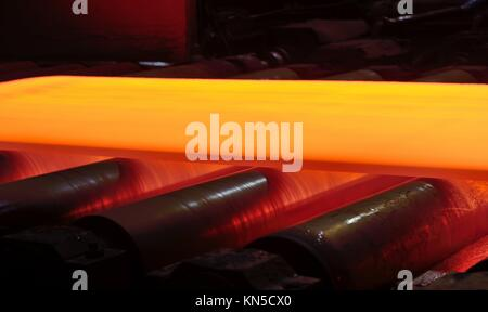steel plate on conveyor inside of plant. - Stock Photo