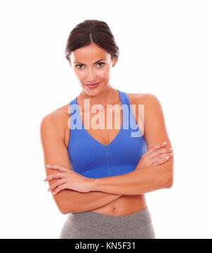 Latin lady in sports outfit looking at you against white background. - Stock Photo