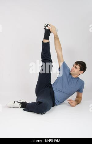 thirty young athletic man does physical exercises. - Stock Photo