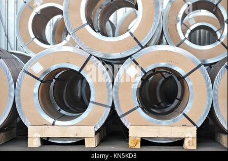 packed rolls of steel sheet. - Stock Photo