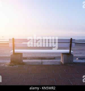 bench near the sea (norderney) in evening. - Stock Photo