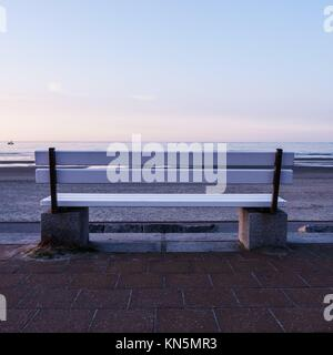 bench and the sea in evening time. - Stock Photo