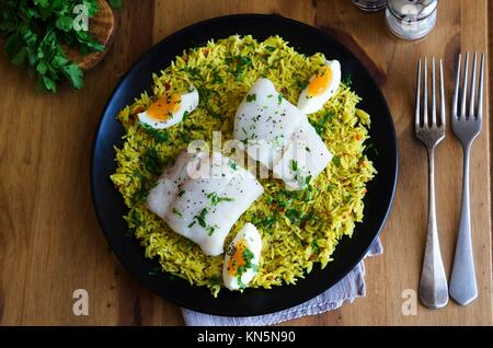 Traditional Kedgeree dish on a plate. - Stock Photo