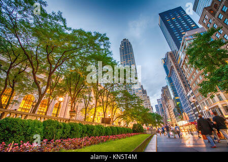 NEW YORK - MAY 17: Tourists relax on 5th Avenue near Public Library on a spring evening, May 17, 2013 in NYC. Fifth - Stock Photo