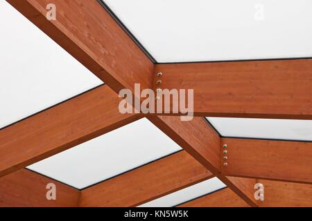 Sun-room patio area with transparent wooden ceiling. - Stock Photo