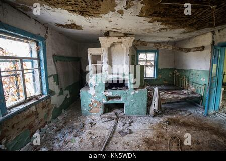 big stove in wooden cottage in small abandoned village called Stechanka, Chernobyl Nuclear Power Plant Zone of Alienation, - Stock Photo