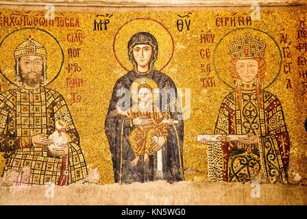 Mosaic of the Virgin Mary with child in arms, flanked by Emperor John II Comnenus and Empress Irene. Galeria south. - Stock Photo
