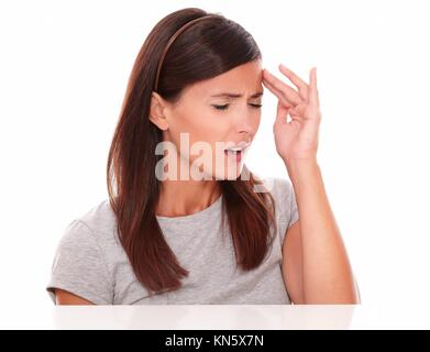Pretty woman suffering from headache with closed eyes on white background. - Stock Photo