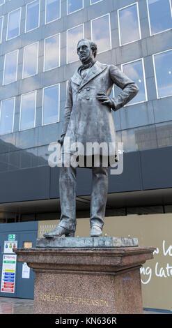 Statue and memorial to civil and railway engineer Robert Stephenson at Euston Station, London, UK - September 2015 - Stock Photo