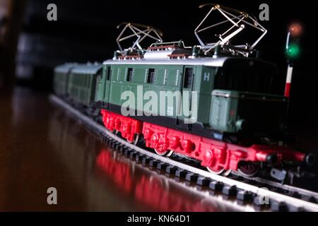 model railroad with steam locomotive by night. - Stock Photo