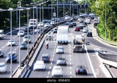 cars on highway in late afternoon. - Stock Photo