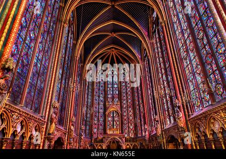 Stained Glass Cathedral Saint Chapelle Paris France. Saint King Louis 9th created Sainte Chapelle in 1248 to house - Stock Photo
