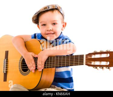 Boy wondering what's to next song, white background. - Stock Photo