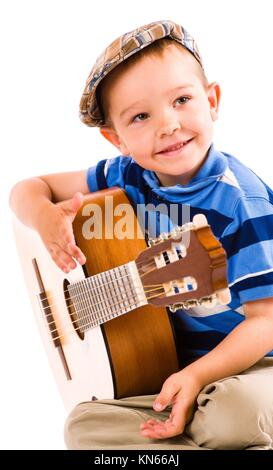 The showman, 5 years old boy and guitar, white background. - Stock Photo