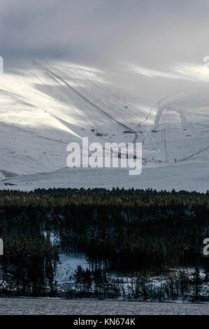 Snow covered Glenmore Forest Park and the  the Avieomore ski centre on the slopes of the Cairngorm mountains near - Stock Photo