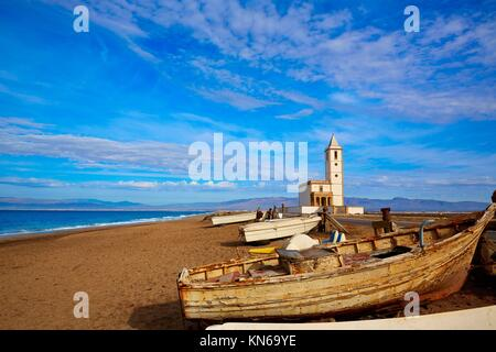 Cabo de Gata in Almeria at San Miguel Beach and Salinas church with stranded boats. - Stock Photo