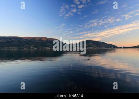 Sunrise over Okanagan Lake, City Park, Kelowna City, Okanagan valley, British Columbia, Canada - Stock Photo