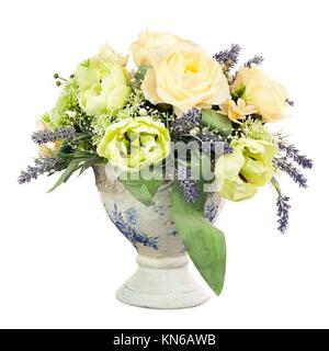 Bouquet from artificial flowers arrangement centerpiece in old vase isolated on white background.