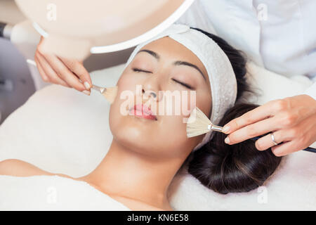 Close-up of the face of a beautiful woman relaxing during rejuve - Stock Photo