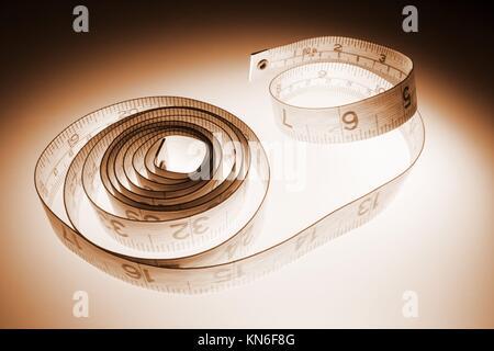 Tape Measure tape measure, measure, measurement, tapeline, linear, scale, inch, centimeter, waistline, size, figure, - Stock Photo