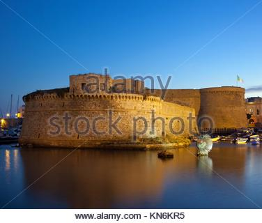 Angevin Castle of Gallipoli by night in Salento, Italy. - Stock Photo