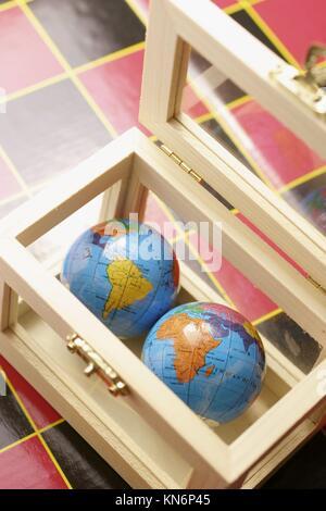 World globes in box. - Stock Photo