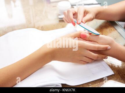 emery polish sandpaper woman nails in Nail Salon. - Stock Photo