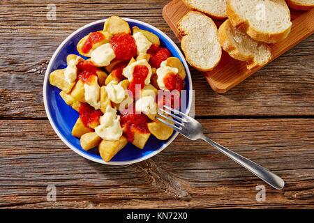 Tapas Patatas Bravas potatoe fries with tomato and mayonaise from Spain. - Stock Photo