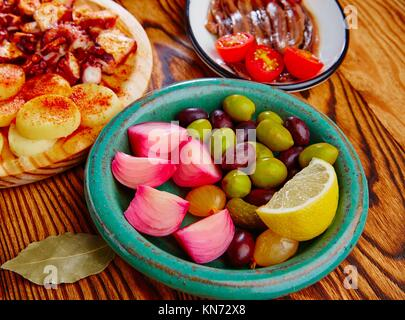 Olives and onion pickles tapas with anchovies and octopus gallega. - Stock Photo