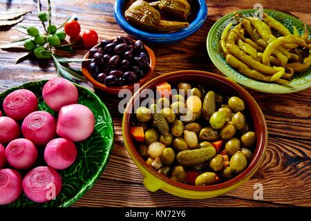 Tapas pickles mix olives chili onion eggplant from Spain. - Stock Photo