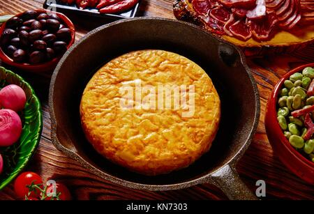 Tapas tortilla de patata potatoes omelette in a pan from Spain. - Stock Photo