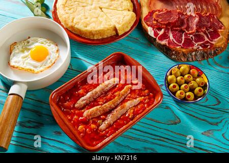 Tapas pisto con tomate ratatouille egg and sausage from Spain. - Stock Photo