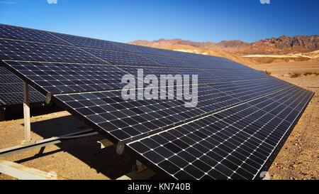 Solar panels soak up the desert sun in Death Valley National Park. - Stock Photo