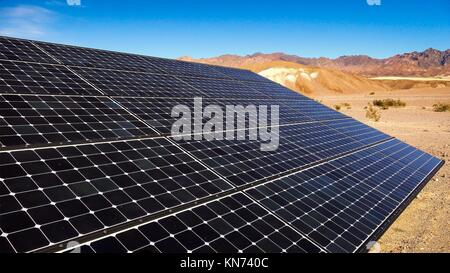 Solar panels soak up the sun in the Mojave Desert in Death Valley National Park. - Stock Photo