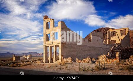 Ruins of the Rhyolite ghost town bank near Death Valley. - Stock Photo