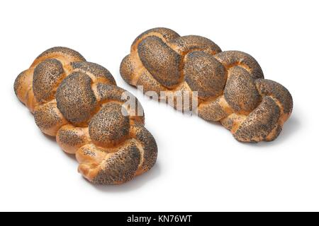 Whole fresh Challah breads with poppy seeds on white background. - Stock Photo