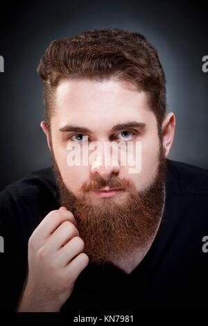 Portrait of a Teenage Hipster with Beard. - Stock Photo