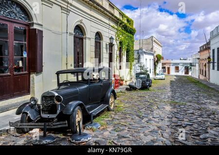 Old black automobile on the street of Colonia del Sacramento, a colonial city in Uruguay. - Stock Photo