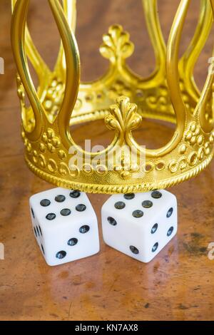 Golden crown and pair of dice. Concept of luck, success and fortune. - Stock Photo