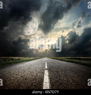 Highway and the moon. Elements of this image furnished by NASA. - Stock Photo