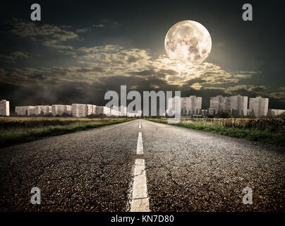 Highway to district under the moon. Elements of this image furnished by NASA. - Stock Photo
