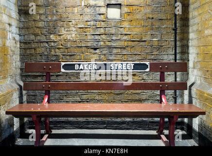 Bench at Baker Street tube station. - Stock Photo