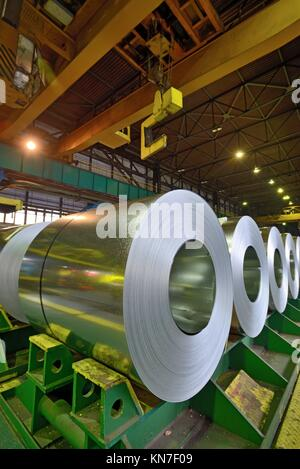 rolls of steel sheet stored in warehouse. - Stock Photo